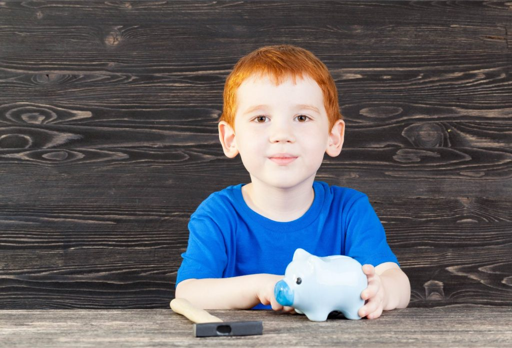 kid with a pig toy
